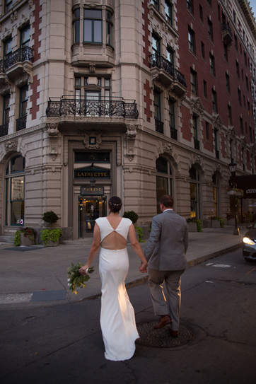 bride and groom walking into Hotel Lafayette in downtown Buffalo