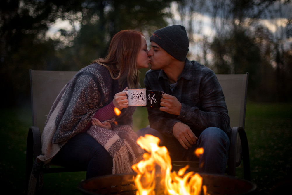 intimate emotional camp fire engagement session in the fall Orchard Park NY