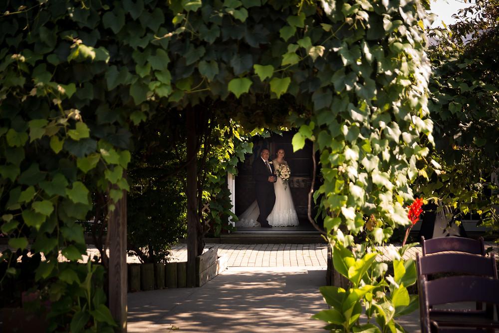 bride walking down aisle with dad at Becker Farms Vizcarra Vineyards Gasport NY intimate wedding covid