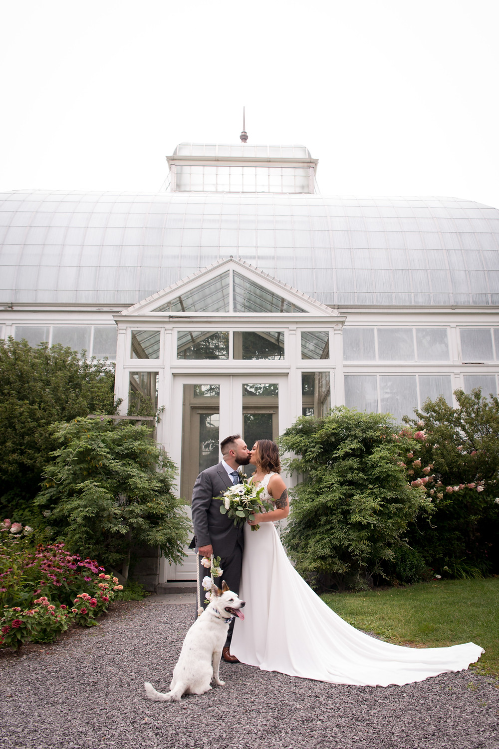 Buffalo Erie Botanical Gardens Wedding Photo with Bride Groom and flower pup