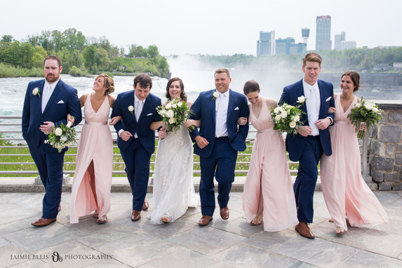 wedding party drunk walk with bride and groom at Niagara Falls State Park NY USA photo
