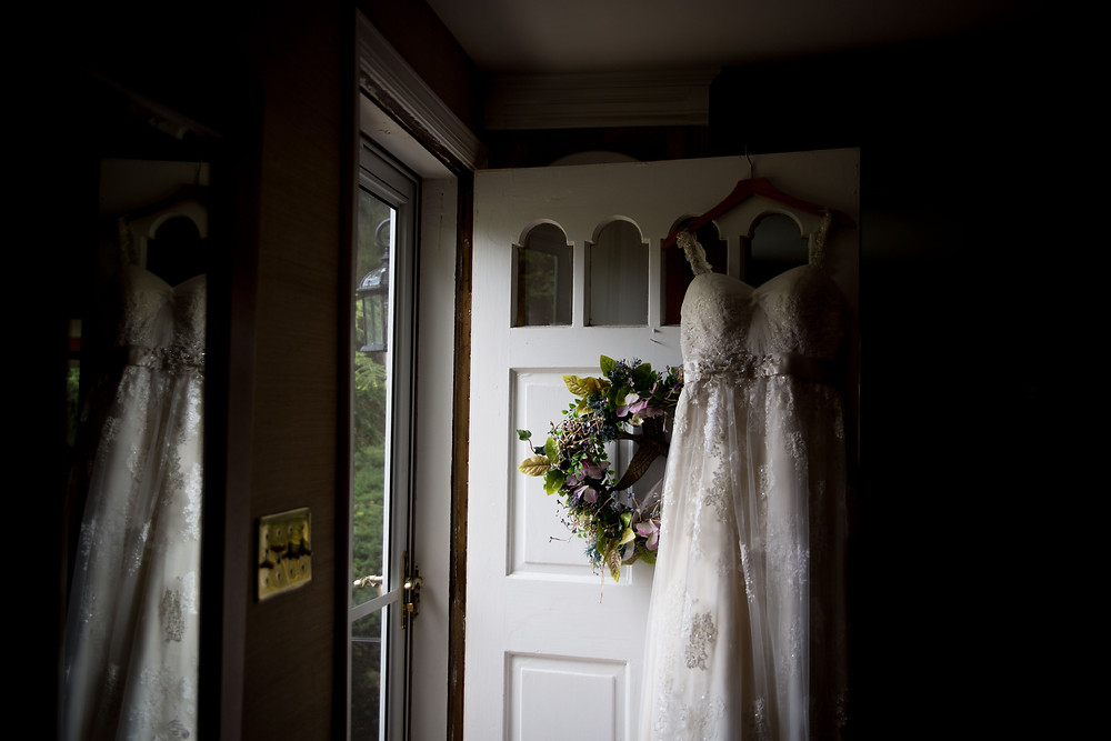 dress hanging on front door of childhood parents home - 13 must have getting ready wedding day photos