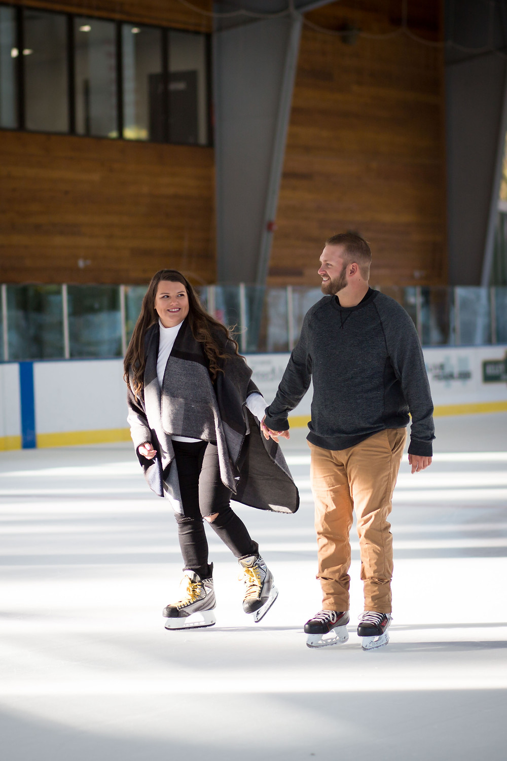 fun engagement session idea ice skating healthy zone rink in East Aurora NY