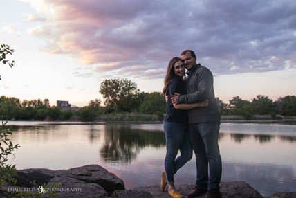 happy couple at Tifft Nature Preserve in Buffalo NY for sunset engagement session