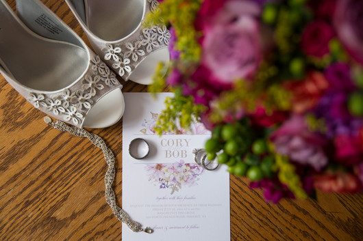 wedding day details of shutterfly invitation rings bracelet shoes and brides bouquet