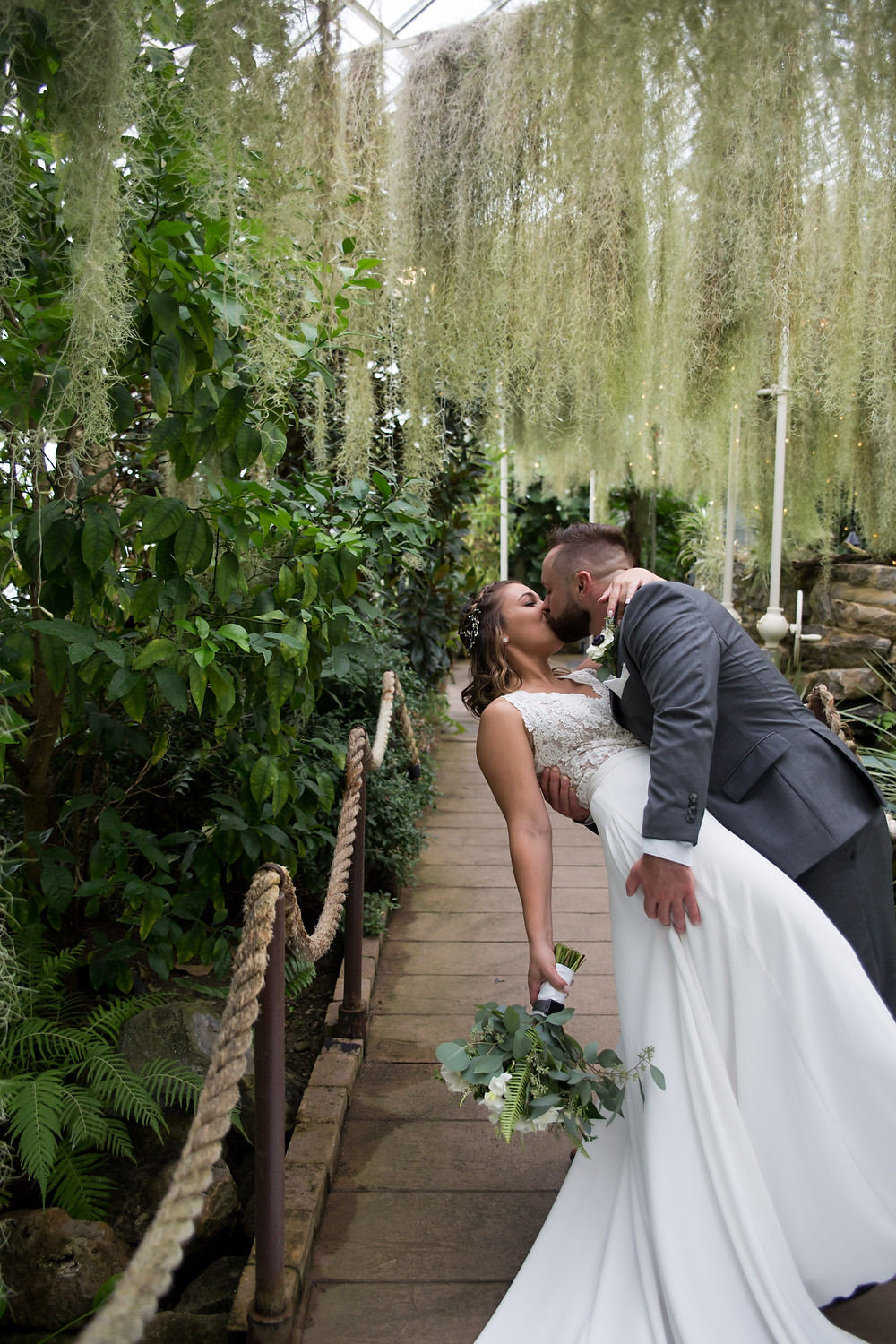 bride and groom photo in moss room at Buffalo Botanical Gardens
