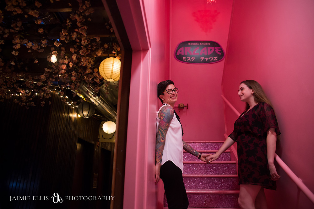 downtown buffalo Misuta Chows pink stairs at the arcade lgbtq same sex wedding engagement photo
