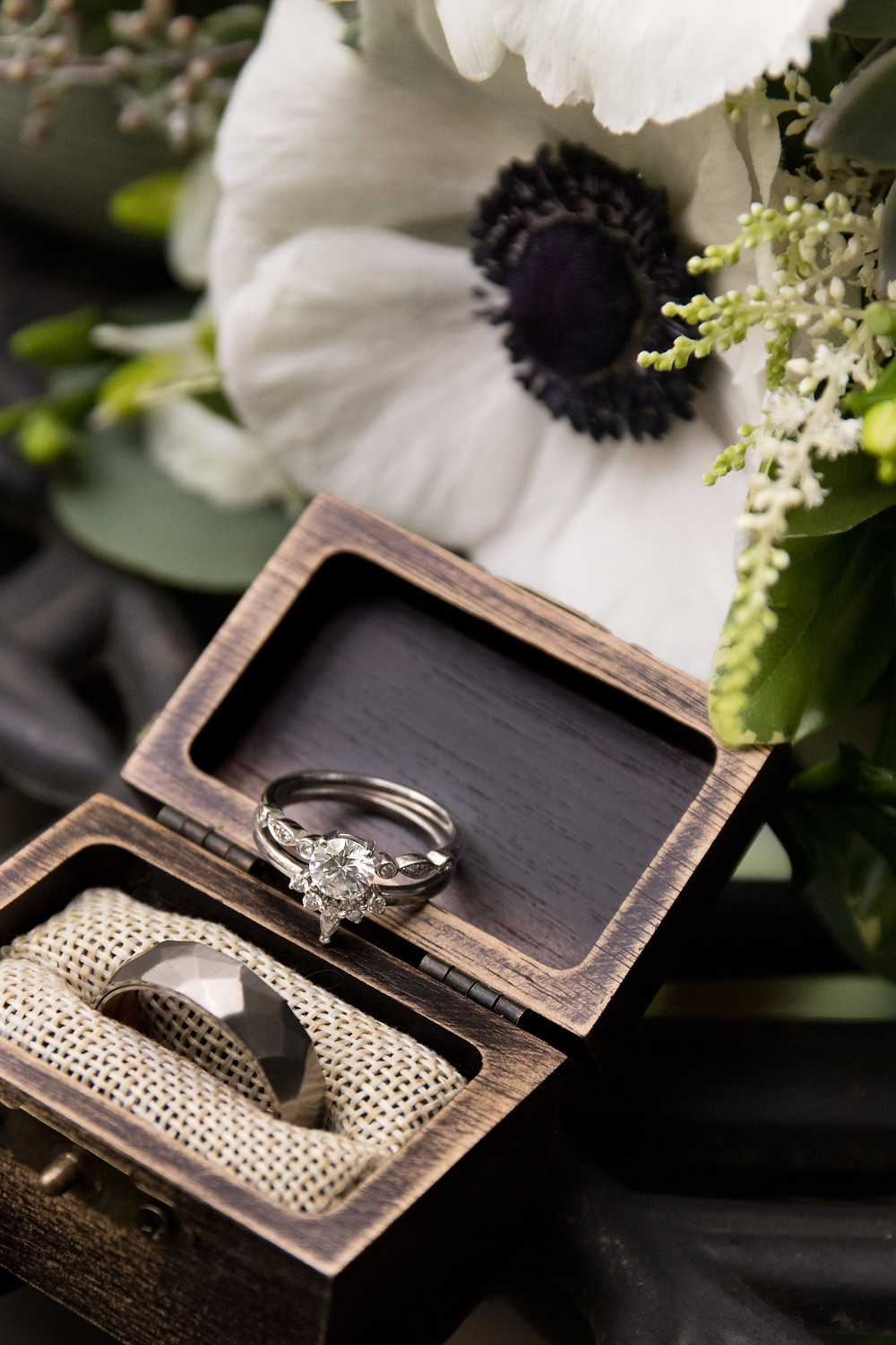 diamond engagement ring with wedding band ring box and bridal bouquet