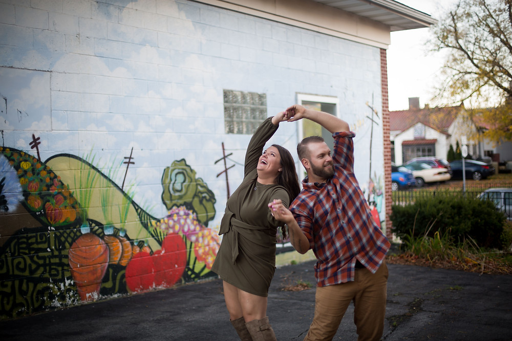 fun east aurora engagement photo with mural
