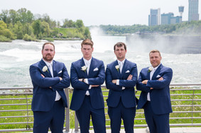 groom with groomsmen get serious after wedding at Niagara Falls State Park NY USA