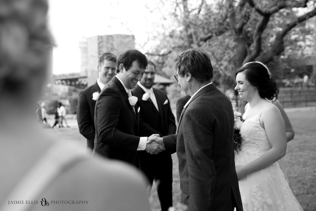dad shaking grooms hand during wedding ceremony at Niagara Falls State Park NY USA