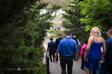 wedding party and family walking through Niagara Falls NY streets to the park for ceremony