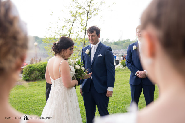 groom looks lovingly at his bride during wedding ceremony at Niagara Falls State Park NY USA