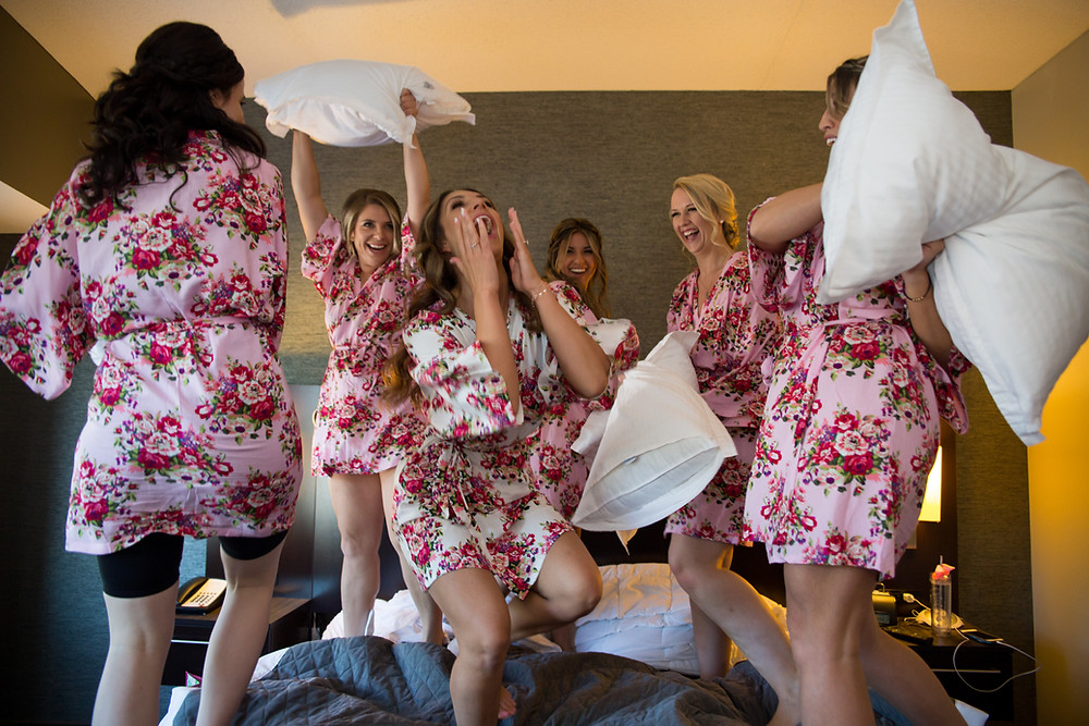 bridesmaids pillow fight in robes - 13 must have getting ready photos on your wedding day