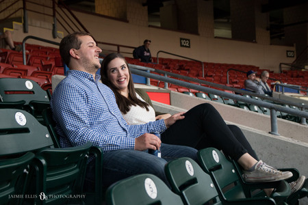 couple enjoying Labatt beer and watching a Buffalo Bisons baseball game at Sahlen Field for engagement photo