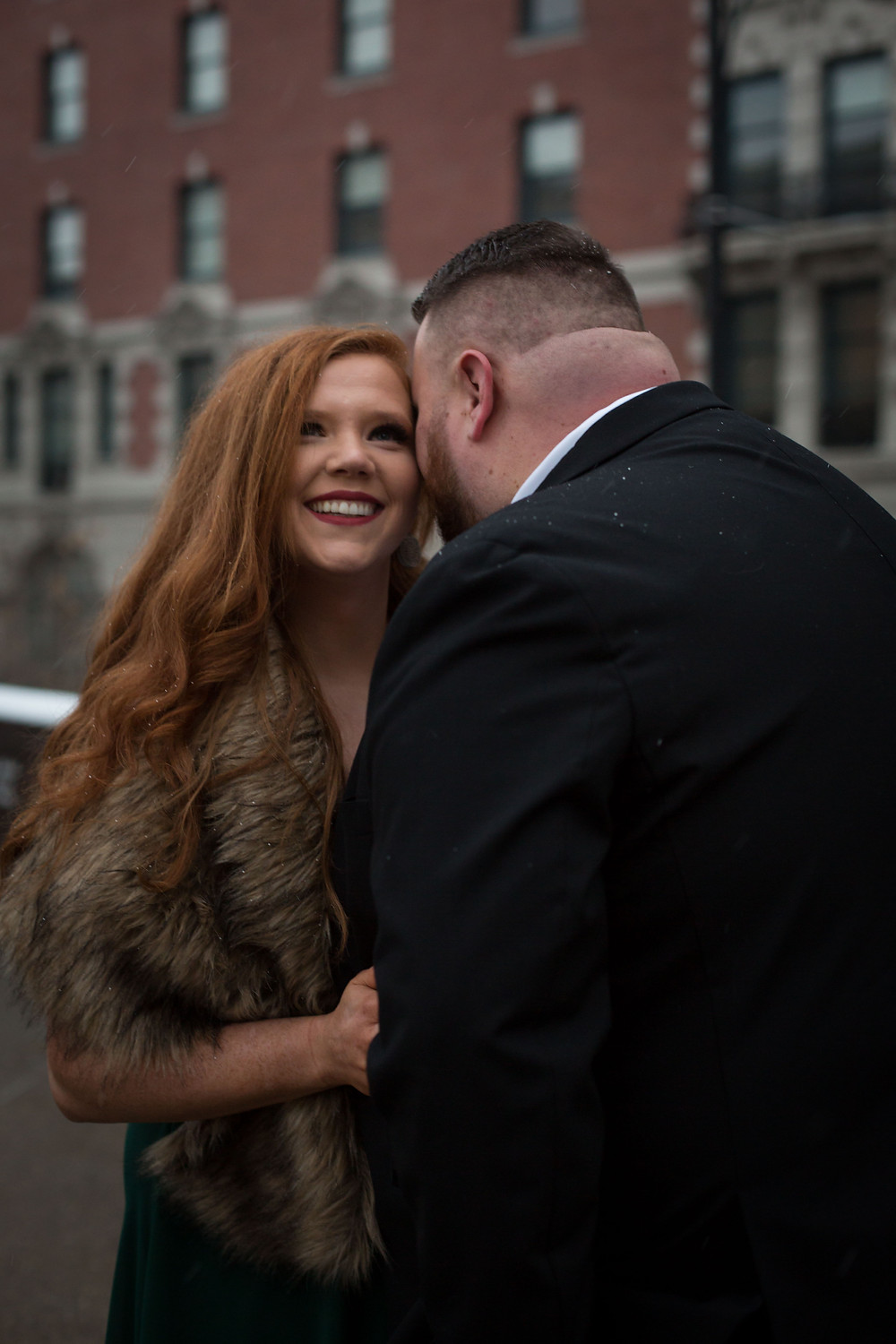 downtown Buffalo snowy winter formal engagement photo shoot