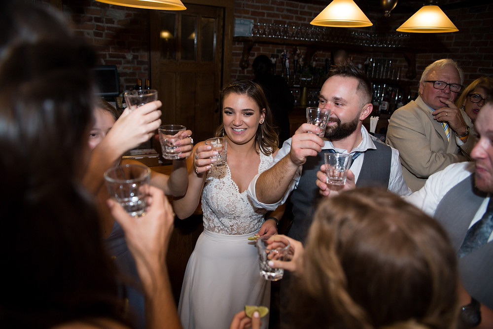 group cheers drinking dancing at Buffalo wedding venue Pearl St Grill