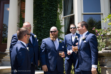groomsmen hanging out outside of Delaware Mansion in Buffalo NY