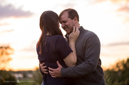 happy laughing couple at Tifft Nature Preserve in Buffalo NY for golden hour engagement session