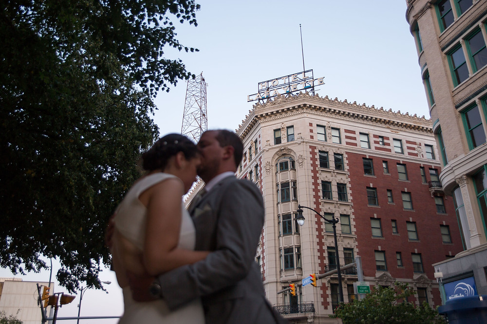 bride and groom outside downtown Buffalo's Hotel Lafayette