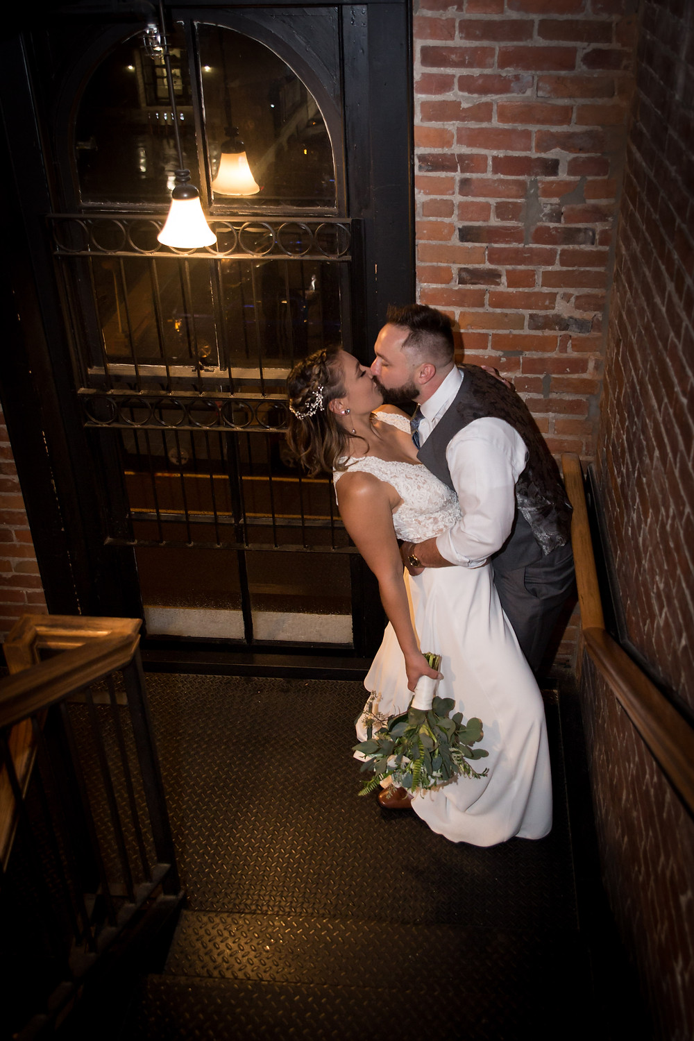 bride and groom wedding photo inside Buffalo venue Pearl St Grill