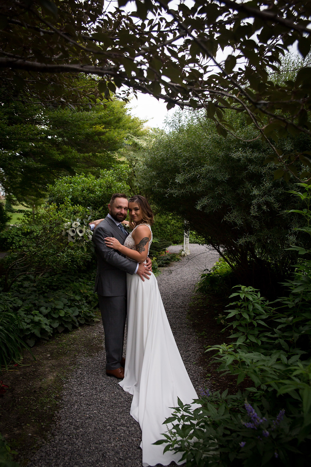 bride and groom wedding portrait outside at Buffalo Botanical Gardens