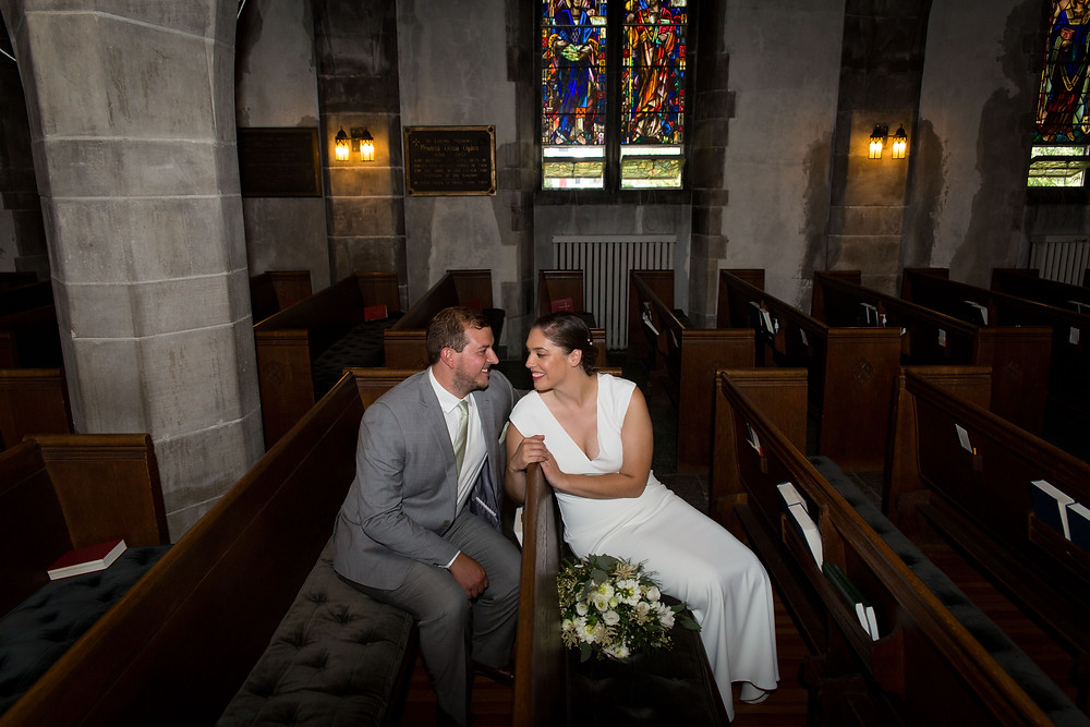bride and groom inside St Johns Grace Episcopal Church Bidwell Buffalo
