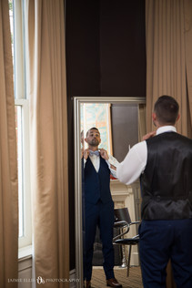 groom getting ready for his wedding at Mansion on Delaware in Buffalo NY
