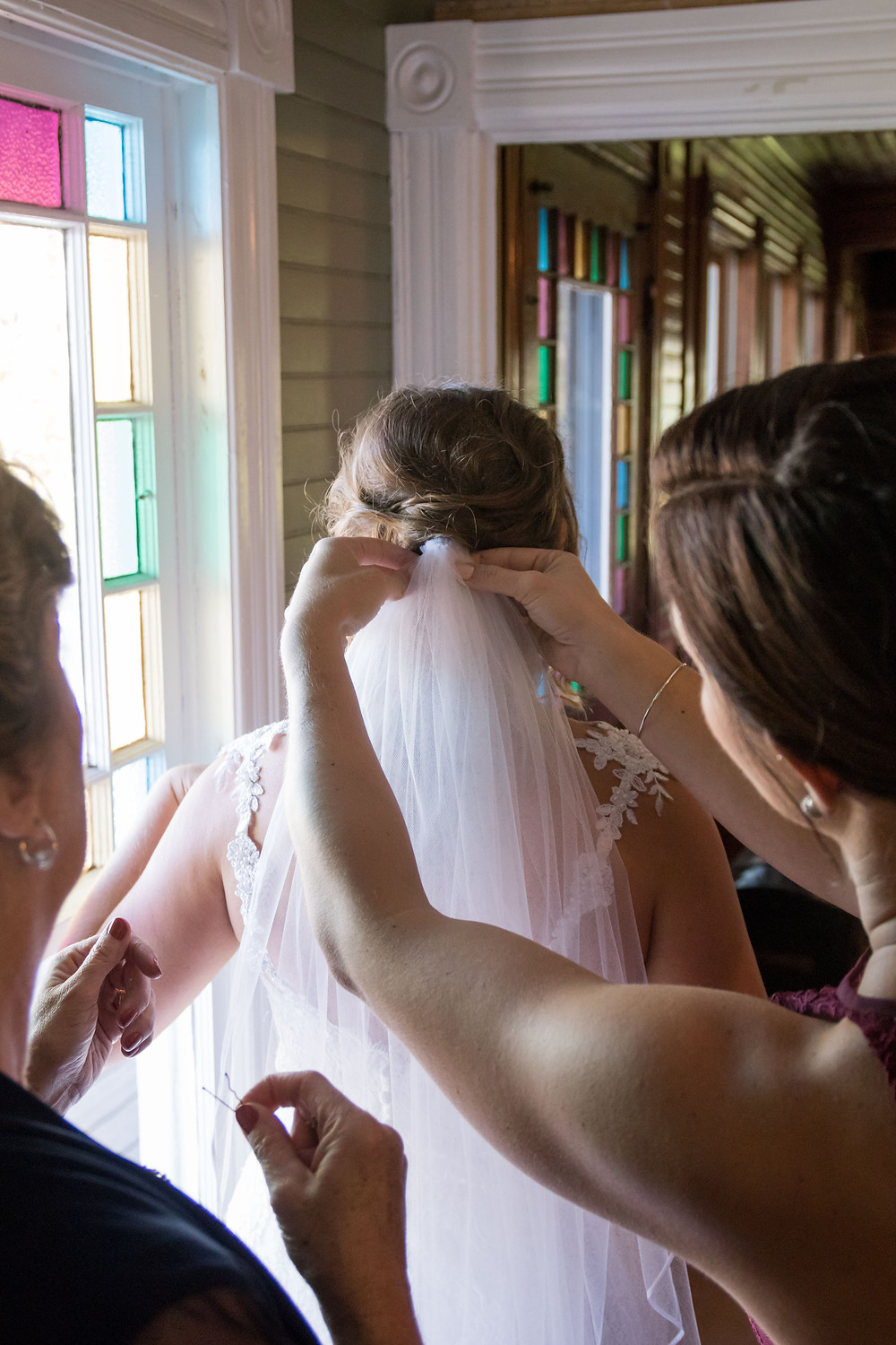 putting the brides veil on - 13 must have getting ready photos on your wedding day