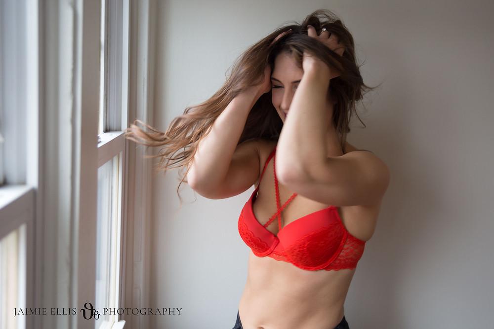 Hair flipping fun boudoir photo in Buffalo NY