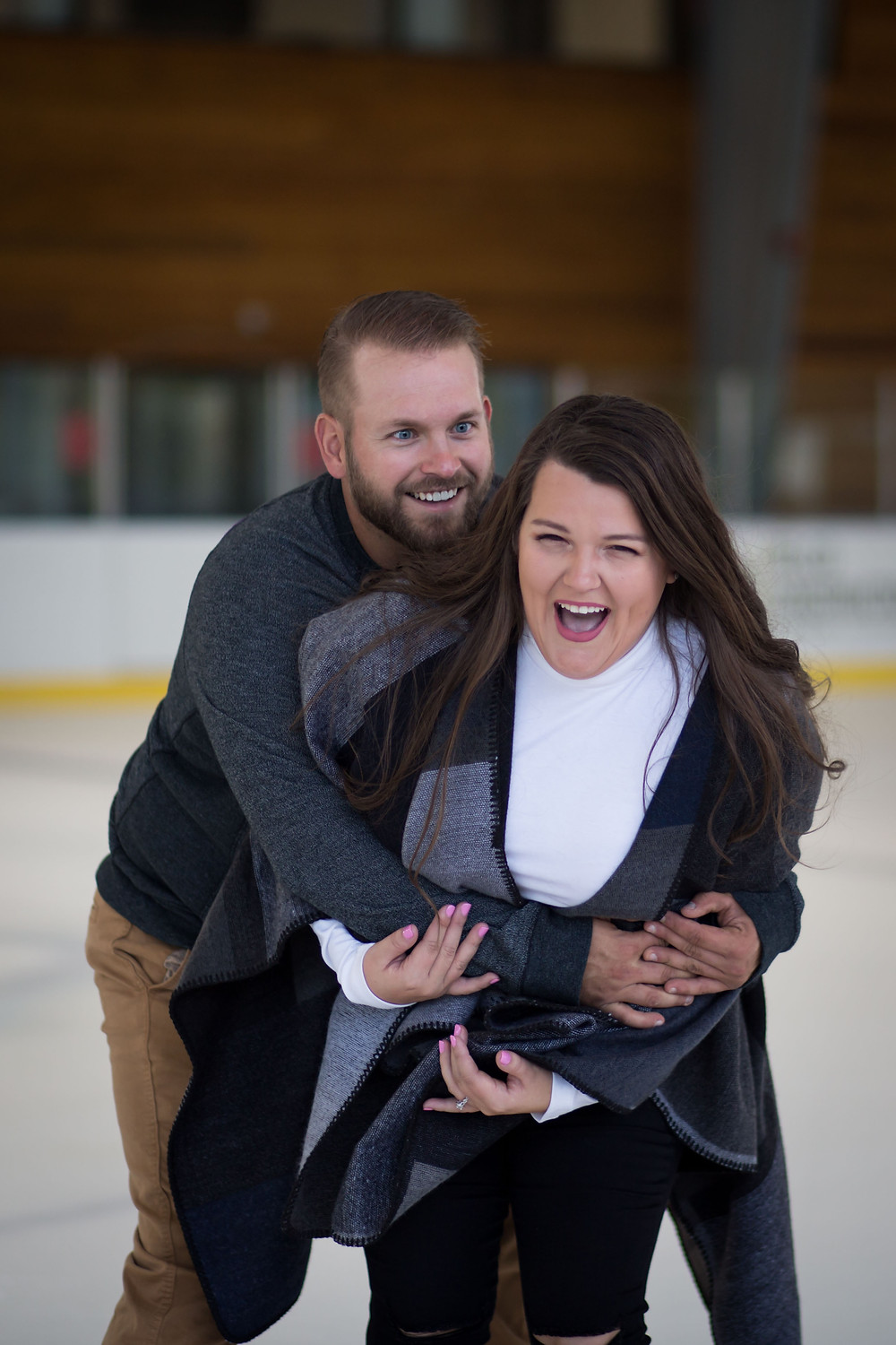 healthy zone east aurora ice rink couple skating engagement photo