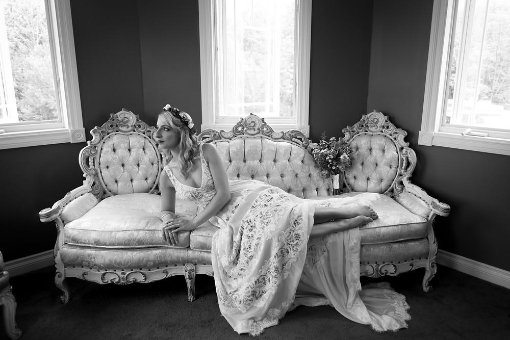 bride portrait on antique couch at La Esposita Bonita Estate Wedding in Varysburg NY