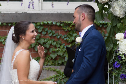 bride and groom emotionally share vows at Mansion on Delaware wedding ceremony in Buffalo NY