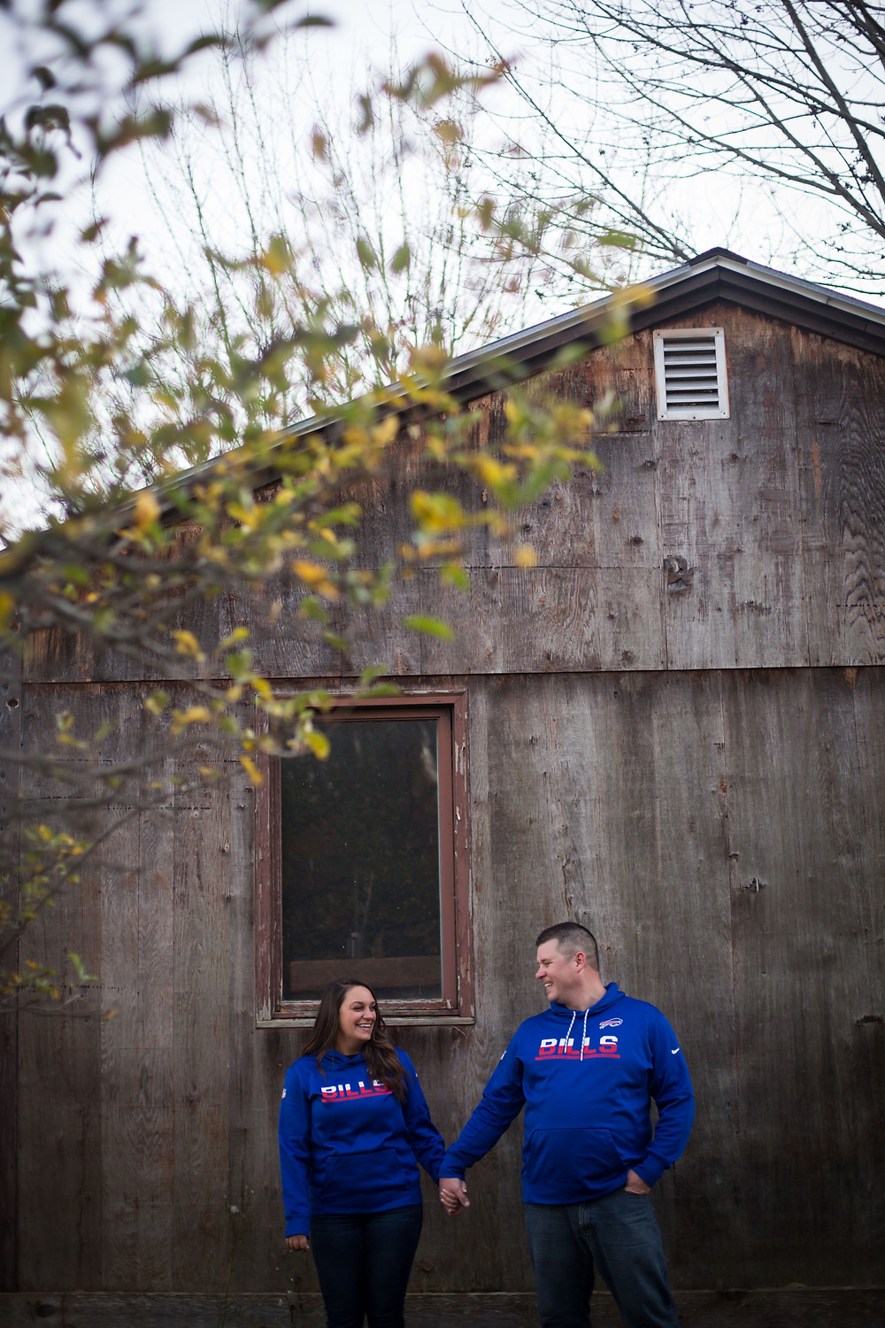 Geneseo NY fall Buffalo Bills couples engagement candid photo