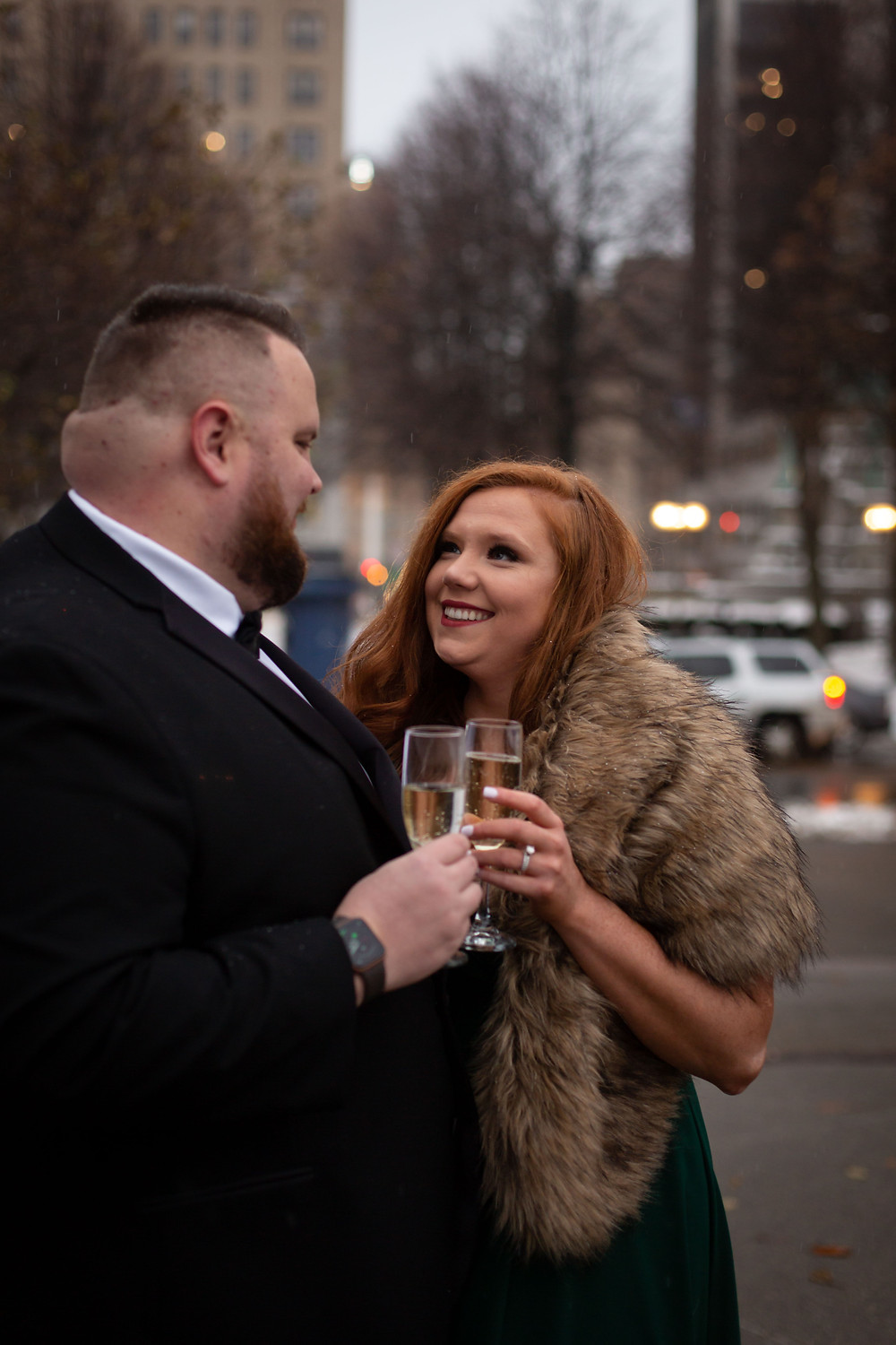 downtown Buffalo winter formal engagement photo shoot with champagne toast