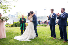 bride and groom exchange first kiss during intimate wedding ceremony photo at Niagara Falls State Park NY USA