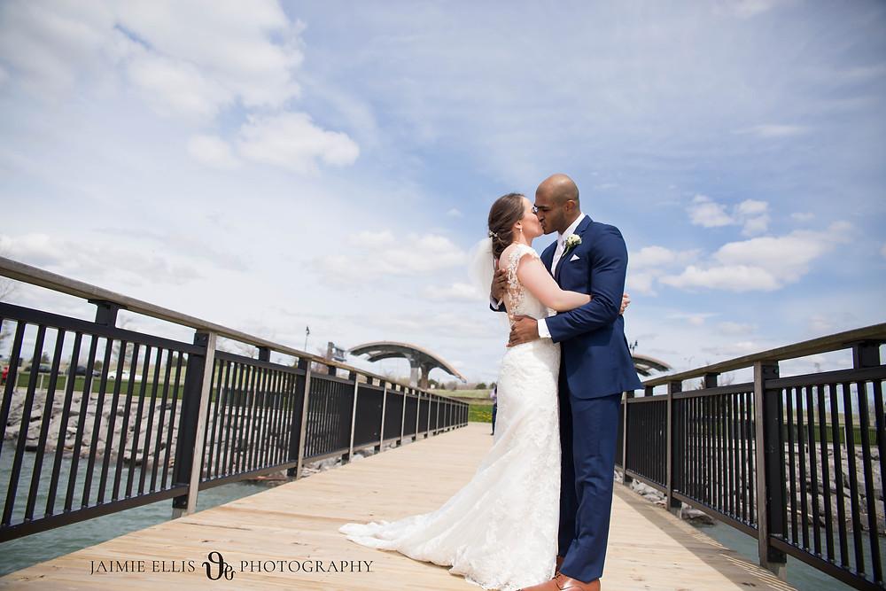 bride and groom kissing photo Gallagher Pier Buffalo NY wedding