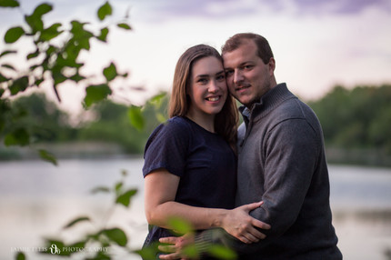 happy couple at Tifft Nature Preserve in Buffalo NY for golden hour engagement session