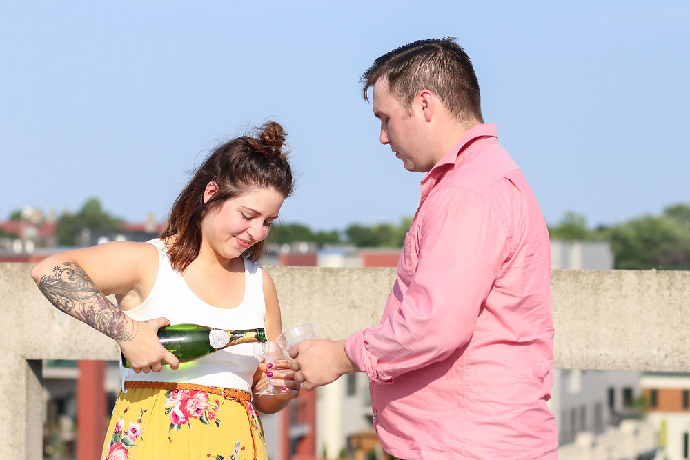 downtown Rochester Engagement Champagne rooftop
