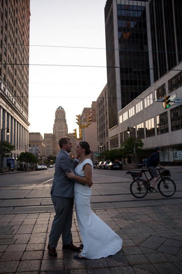bride and groom dancing outside Buffalo City Hall at sunset