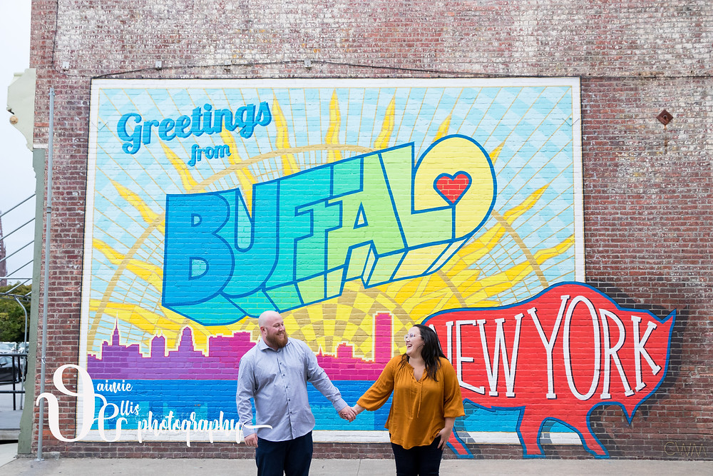 downtown Buffalo engagement photos greetings from Buffalo mural