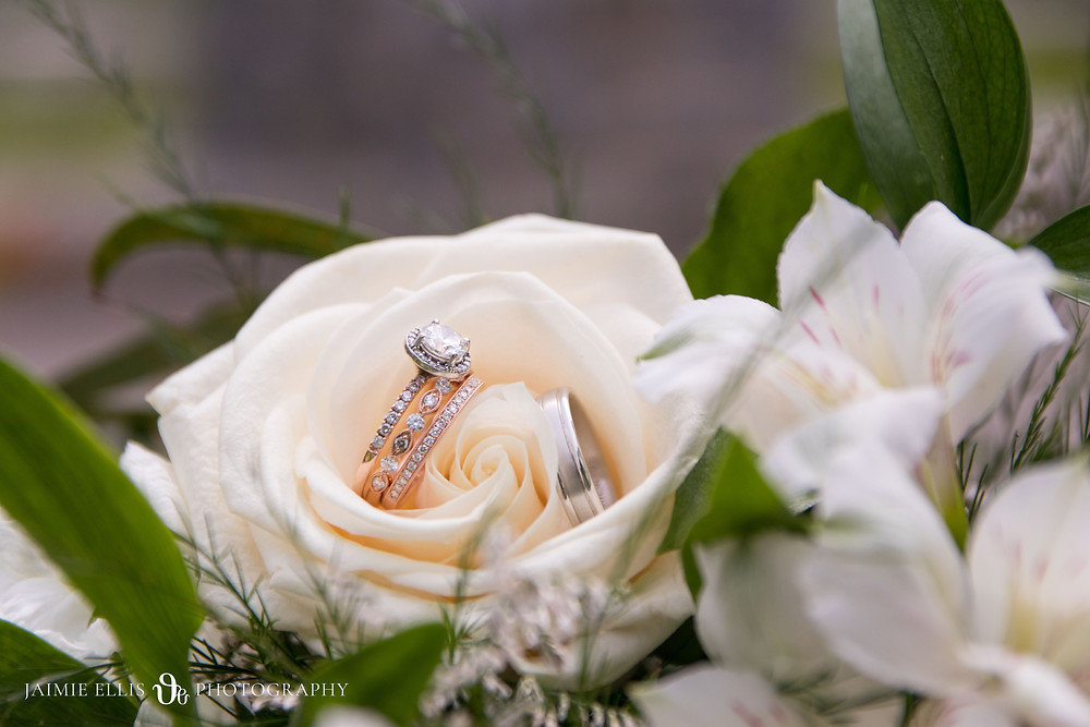 wedding rings with diamond engagement ring in brides bouquet at Niagara Falls wedding
