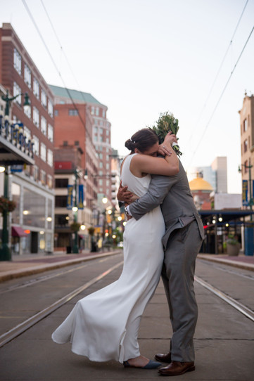 bride and groom on Main st downtown Buffalo at sunset dusk
