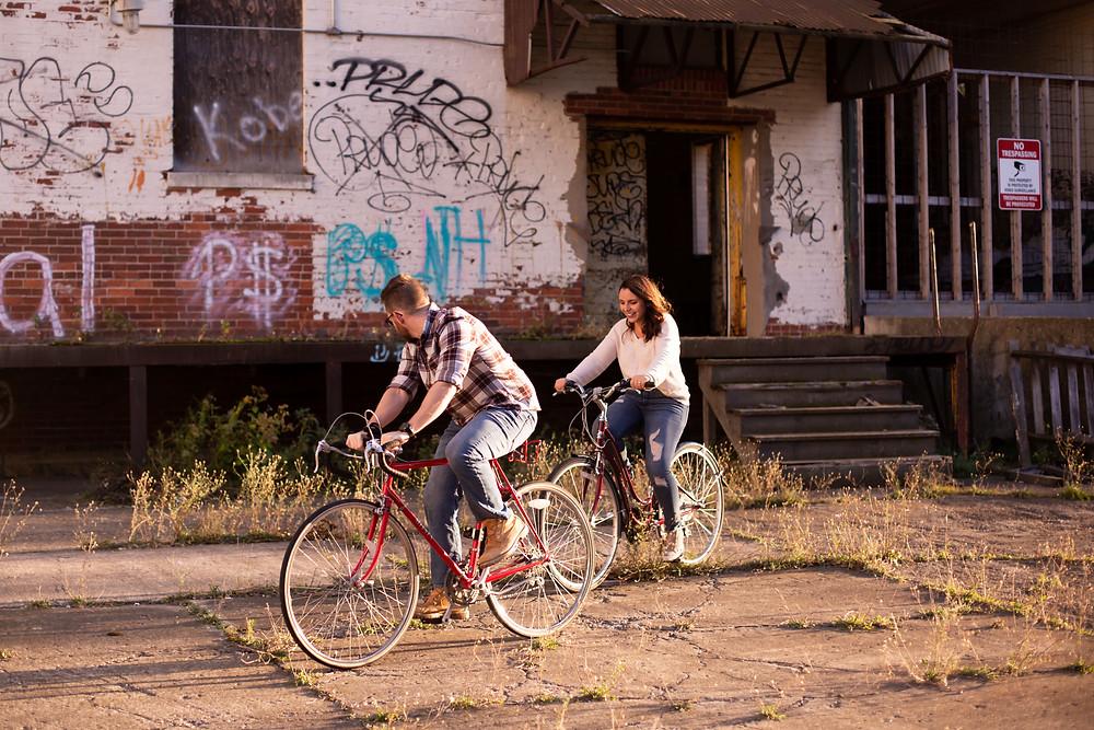 engagement session riding bikes at Silo City Buffalo