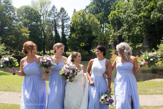 bride with her bridesmaids for portraits at Forest Lawn Cemetery in Buffalo NY