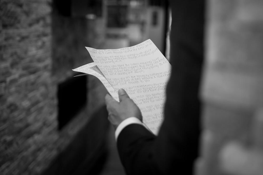 wyndham garden williamsville groom reading letter from bride  photo