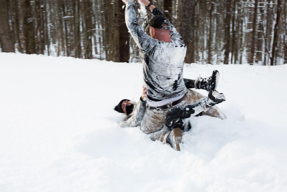 snowball fight winter couples engagement photo buffalo ny