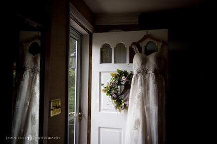 bride's dress on door of childhood home bridal detail photo