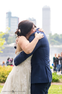 bride and groom hug after intimate wedding ceremony photo at Niagara Falls State Park NY USA