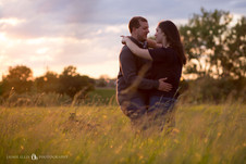 happy dancing couple at Tifft Nature Preserve in Buffalo NY for golden hour engagement session